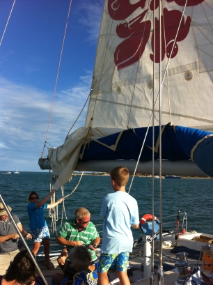 Craig hoisting the sail