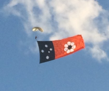 Parachute jumper with the NT flag for Territory Day