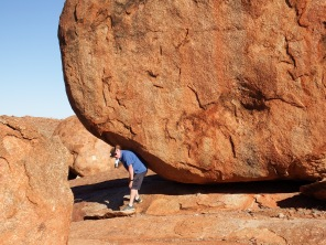 Craig holding up the rock at the Devils Marbles