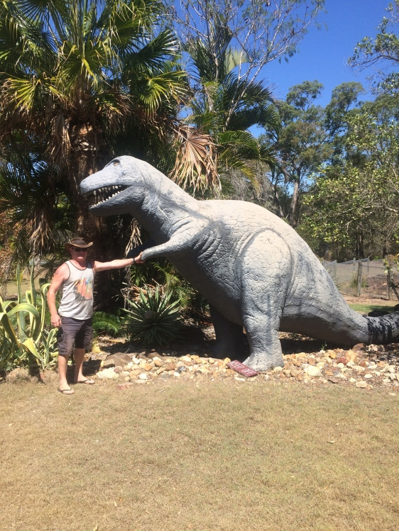 Craig shaking hands with the dino